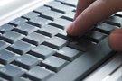 Fingers typing on keyboard