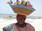 Photo of African woman carrying items in her hat