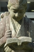 Photo of girl studying, a statue